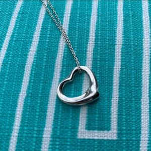 Tiffany & Co Elsa Peretti sterling heart necklace.